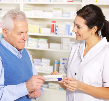 pharmacist and elderly man talking