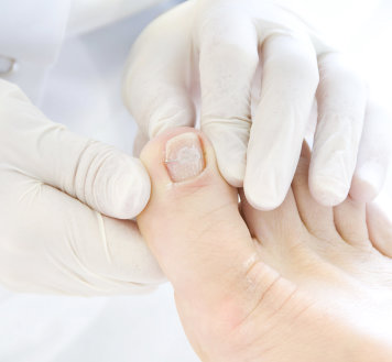 pharmacist holding patient's foot